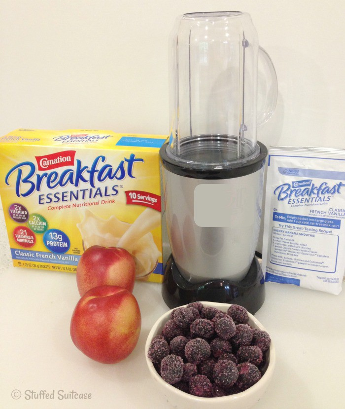 Making a blended smoothie recipe with frozen blueberries, fresh nectarine and vanilla mix | StuffedSuitcase.com