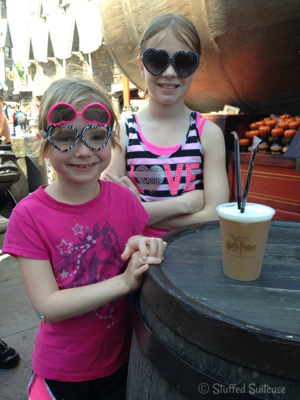 Drinking a ButterBeer (no alcohol) at Universal Orlando Wizarding World of Harry Potter | StuffedSuitcase.com