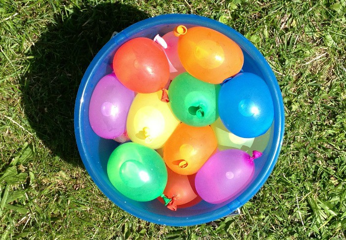 Water play in the backyard with water balloons