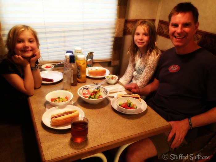 Family Dinner inside Camper during camping trip