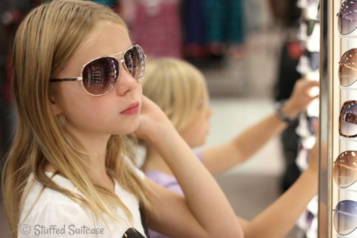 Shopping at Target looking at sunglasses