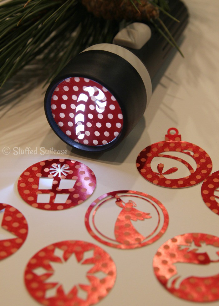 Make your own flashlight projection craft with these DIY Christmas stencils. StuffedSuitcase.com