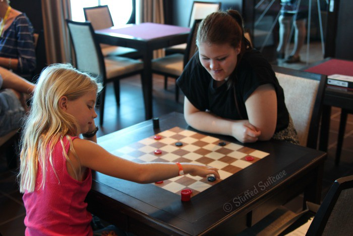 Playing Checkers in the Game Room