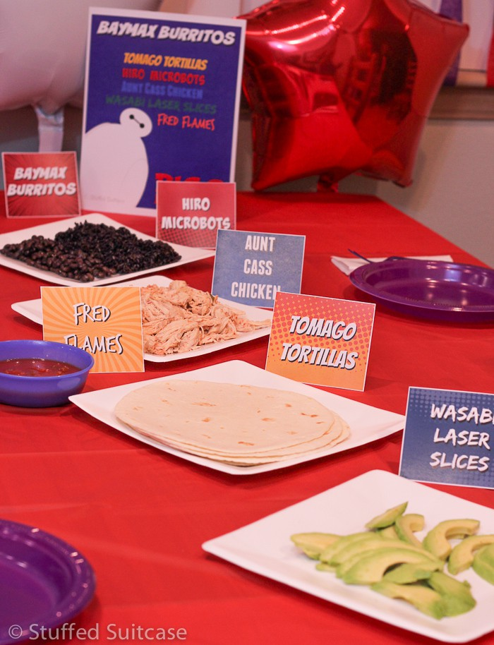 Plan a family fun movie night with the great Disney Big Hero 6 movie featuring Baymax Burritos made from food all based on the movie characters. StuffedSuitcase.com