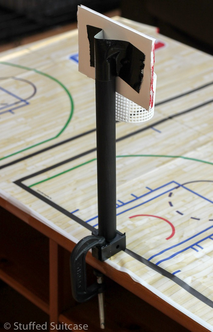 """Tape backboard onto wood dowel and mount to table with 2"""" C clamp"""