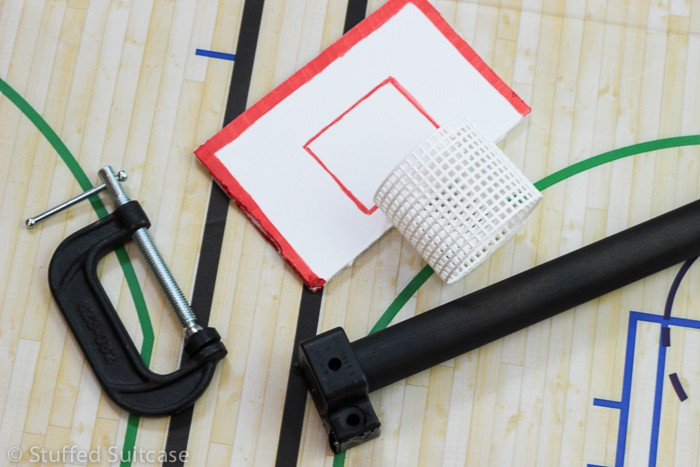 Affix mesh hoop to backboard