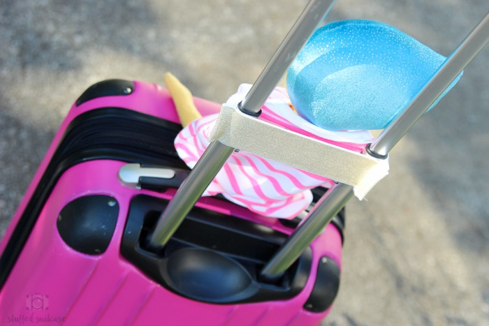 The elastic onesie slides over suitcase handles and you've got a DIY travel carrier for your child's favorite plush friend or stuffed animal!