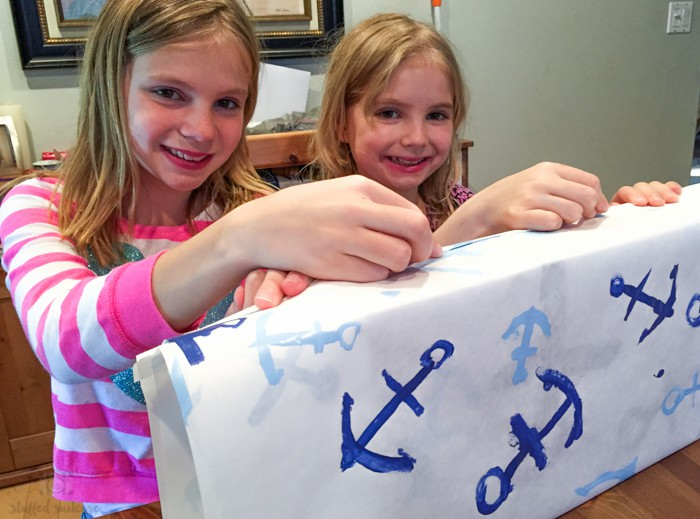 Wrapping our Father's Day gift in our painted anchor wrapping paper