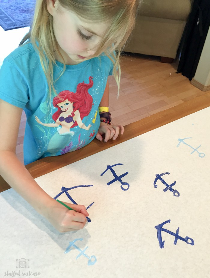 Painting anchors on banner paper for wrapping our Father's Day gift