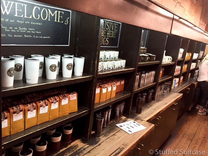 Mugs and coffee line the wall at the first Starbucks store - only available at this location!