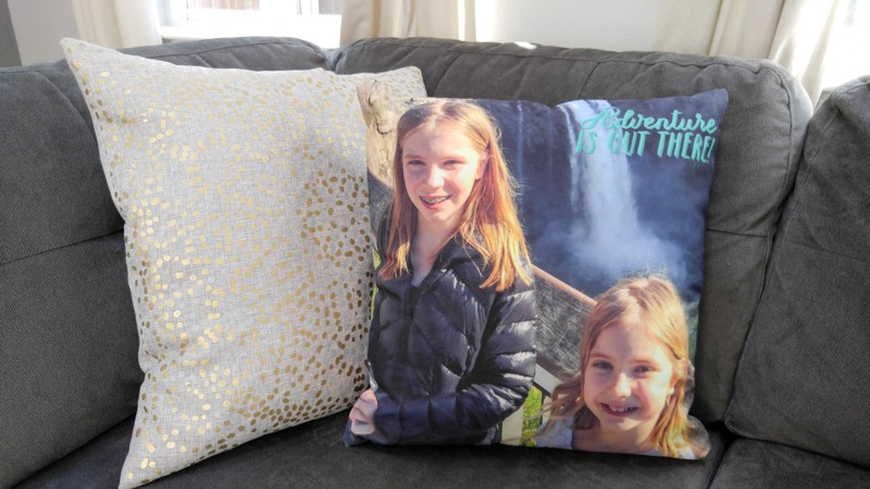 The girls' favorite gift, a custom throw pillow for our couch!
