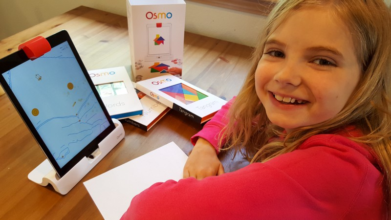 Having fun playing Osmo Newton app