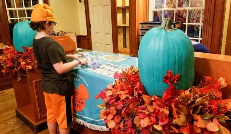 Redeeming tokens for allergy-friendly treats at Mickey's Not So Scary Halloween Party | copyright Stuffed Suitcase
