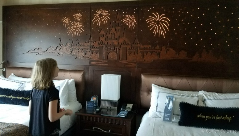 The Disneyland Hotel has fun light up headboards in their rooms - do you see the hidden Mickey? | © Stuffed Suitcase
