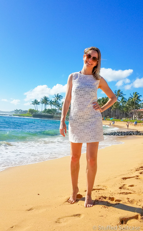 Hanging at Poipu Beach in Kauai, Hawaii in my Vacay perfect lace dress as a beach cover up. © Stuffed Suitcase