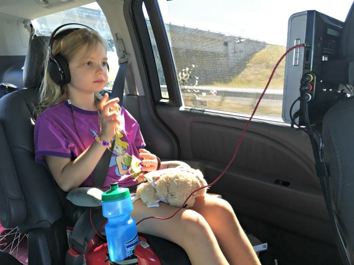 kid watching dvd movie on road trip