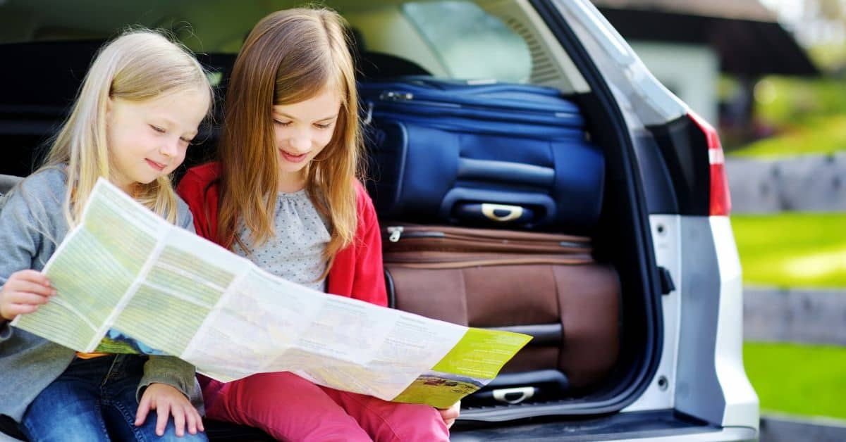 kids with packed car