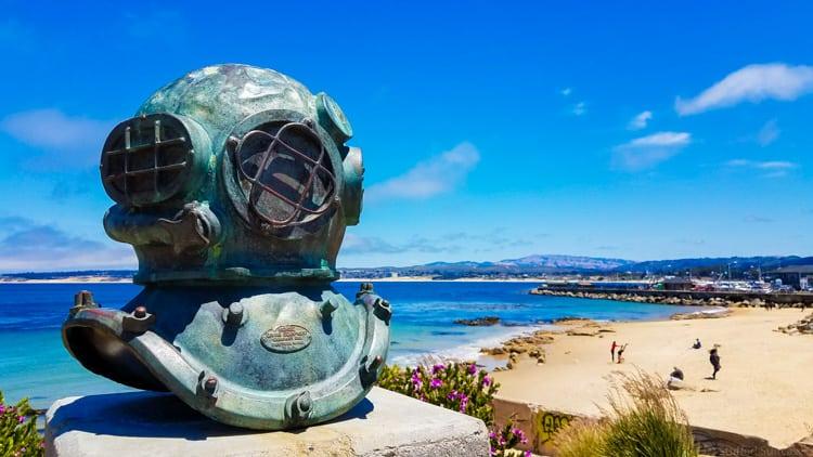 old scuba helmet metal sculpture at san carlos beach in monterey california