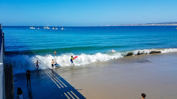 kids playing in waves at municipal beach in monterey
