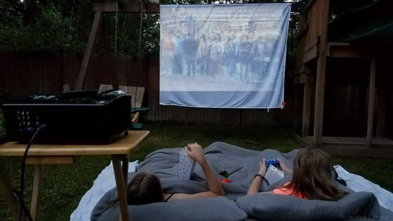 Tips and secrets from our experience putting together a DIY backyard movie screen for outdoor family movie night