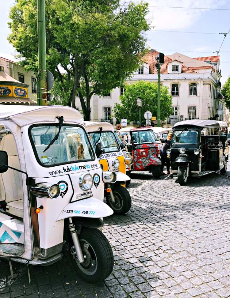 tuk tuks on a street in Lisbon Portugal