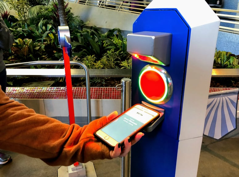 phone scanning a MaxPass FASTPASS at Disneyland copyright Kimberly Tate