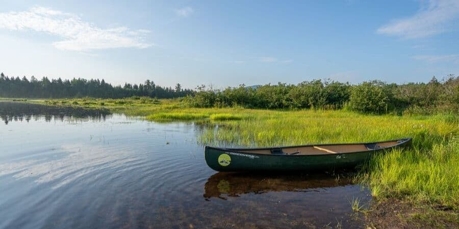 canoe in roach pond near moosehead lake