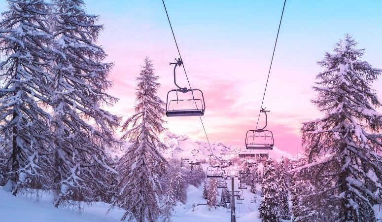ski resort chair lifts at sunset