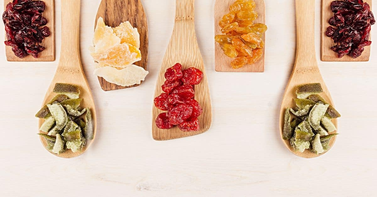 dried fruit on spoons