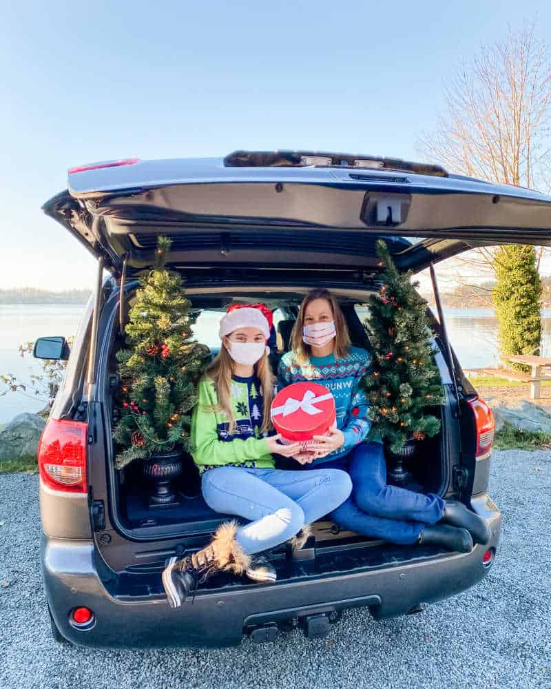 family with holiday decorations in car