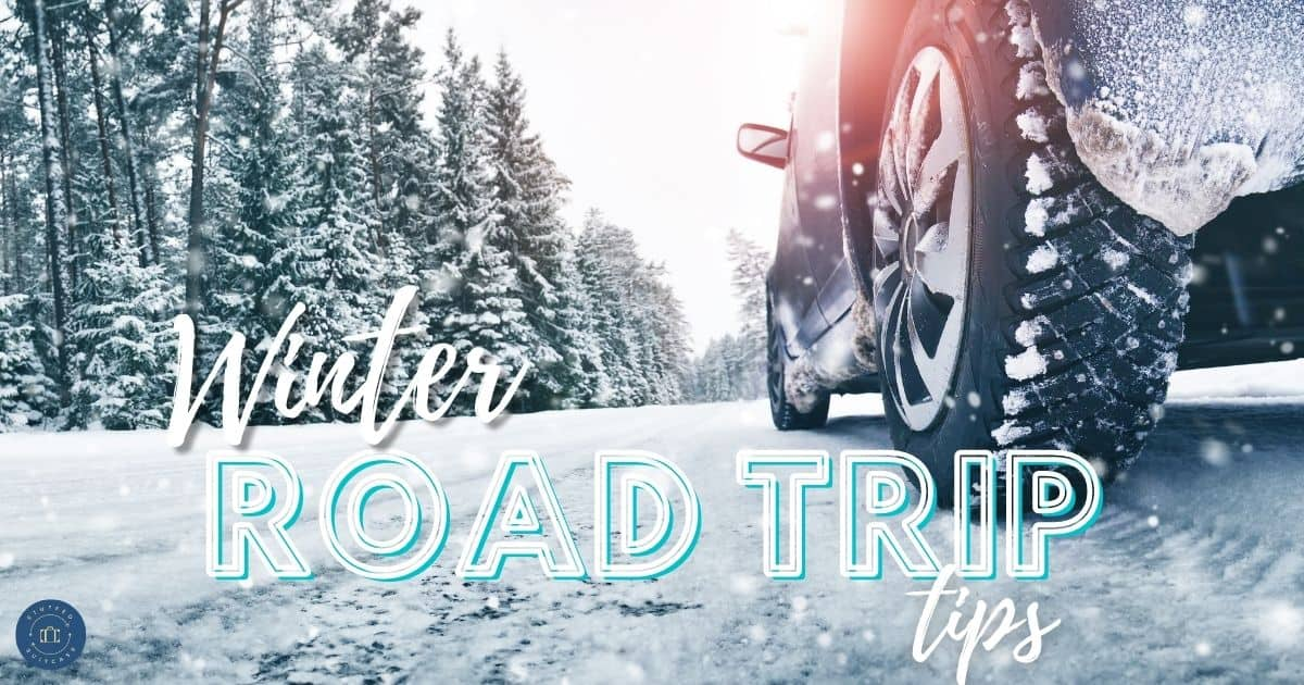 car tire on snow winter road text winter road trip tips