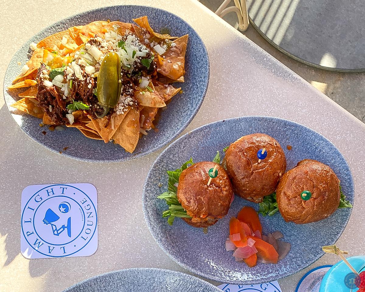 barbacoa nachos and sliders on table at lamplight lounge disneyland