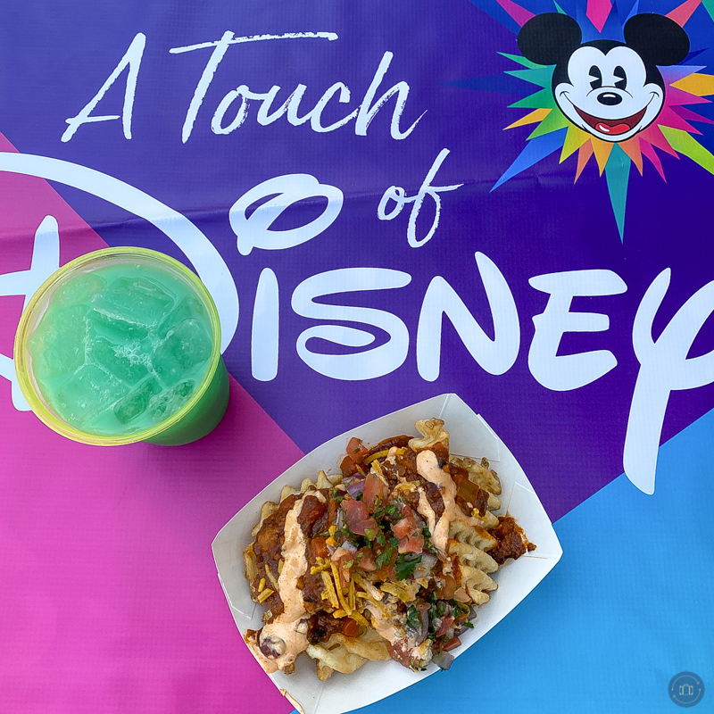 impossible chili fries and blue angeleno cocktail on touch of disney table