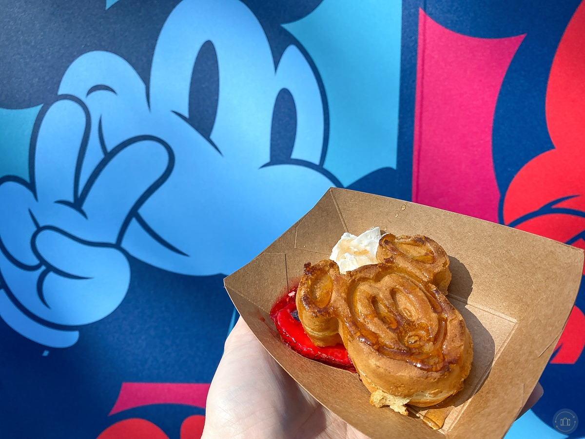 mickey waffle at touch of disney d-lish food marketplace with mickey mural on wall