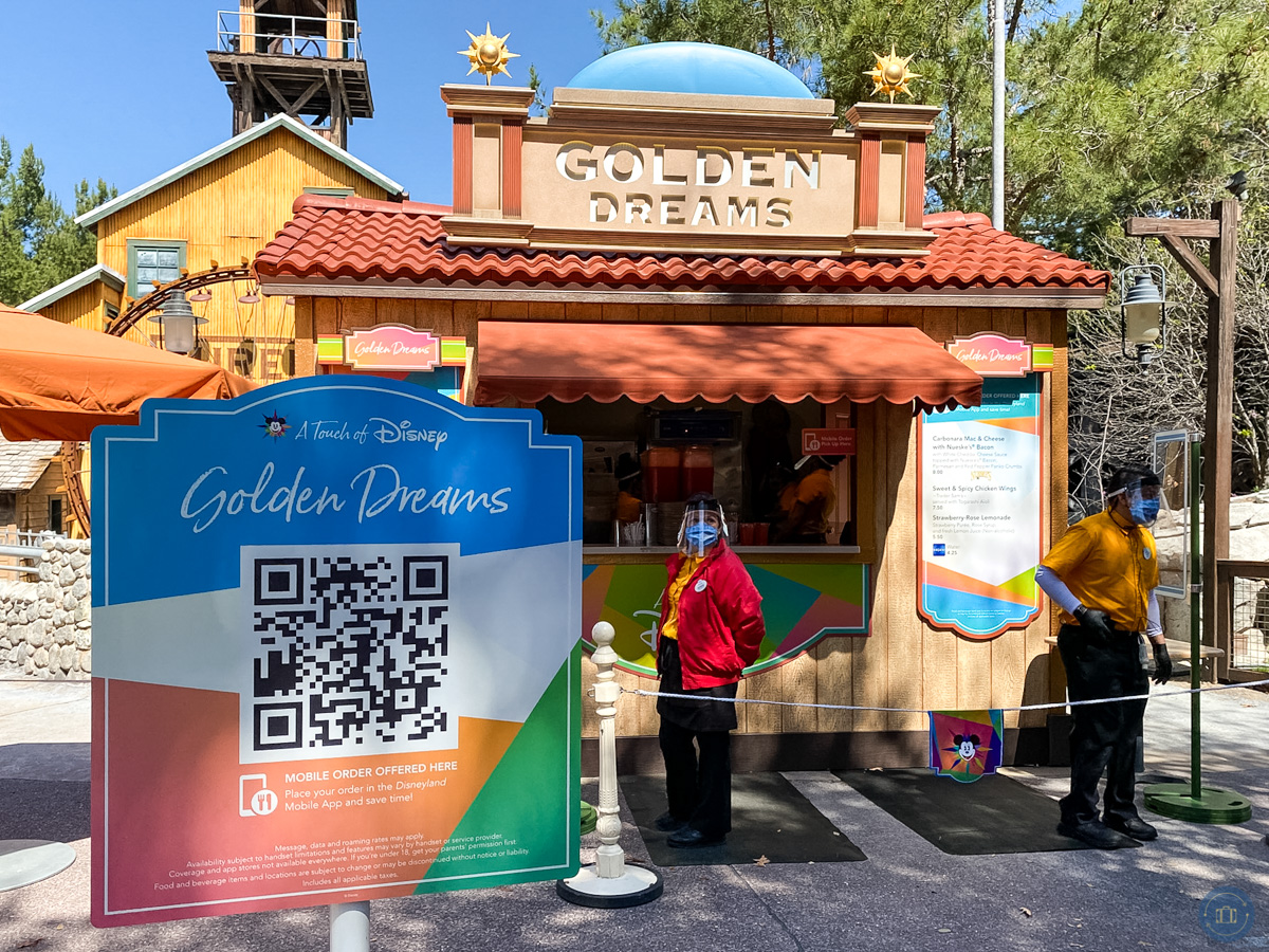 qr sign in front of food marketplace at disney