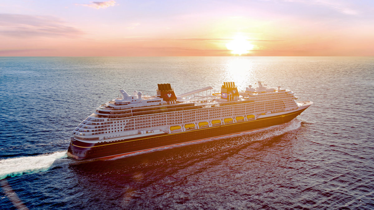 Disney cruise ship at sunset at sea
