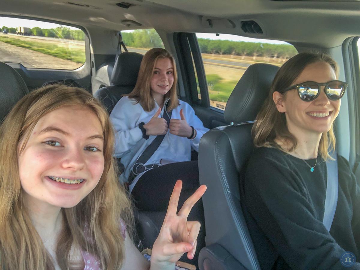 family in van on road trip
