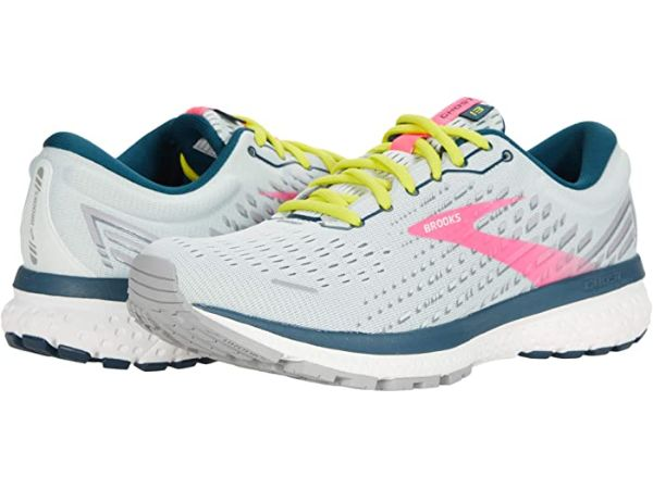 white and pink brooks running shoes