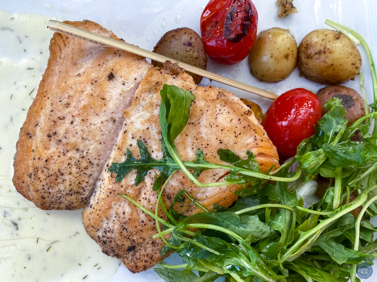 salmon at wine country trattoria with arugula salad and potatoes